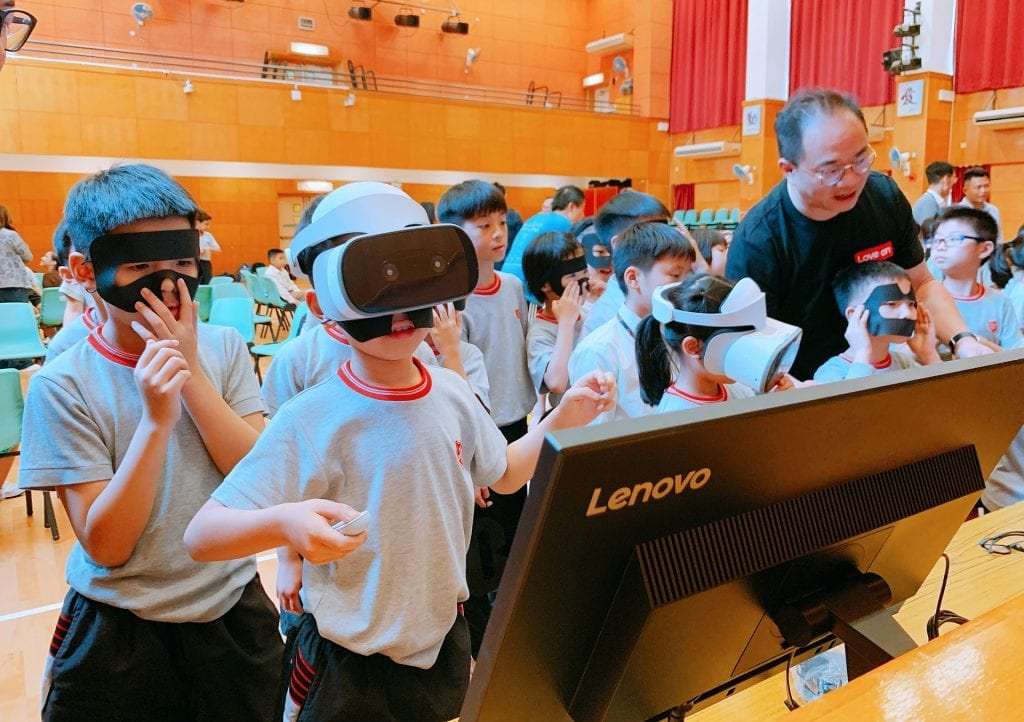 Students in Hong Kong with Lenovo's Mirage Solo VR headsets