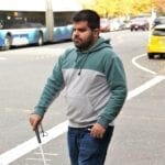 Kartik Sawhney walking on Seattle streets.