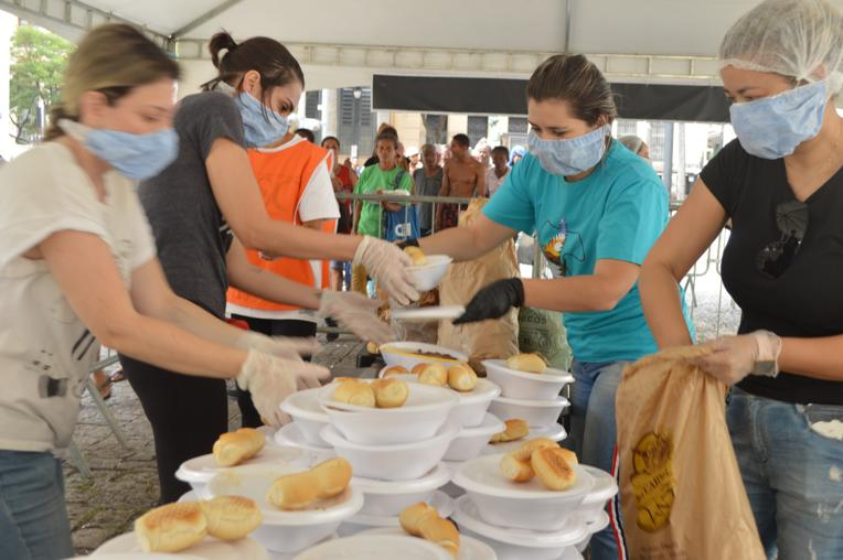 Volunteers assisting the Franciscan monks in providing food to the community during COVID-19