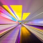 Brand image - colorful lines streaking through a tunnel