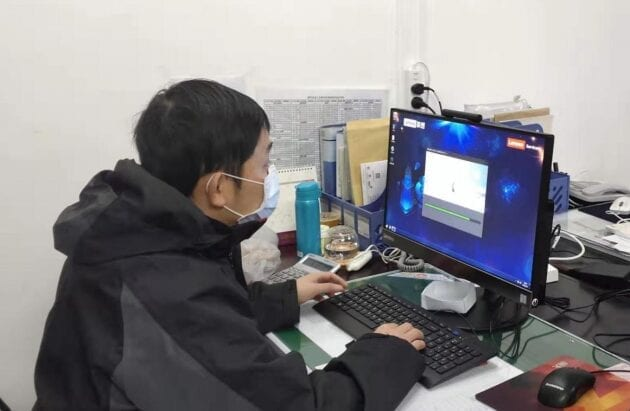 Yaowen Tang working at his PC