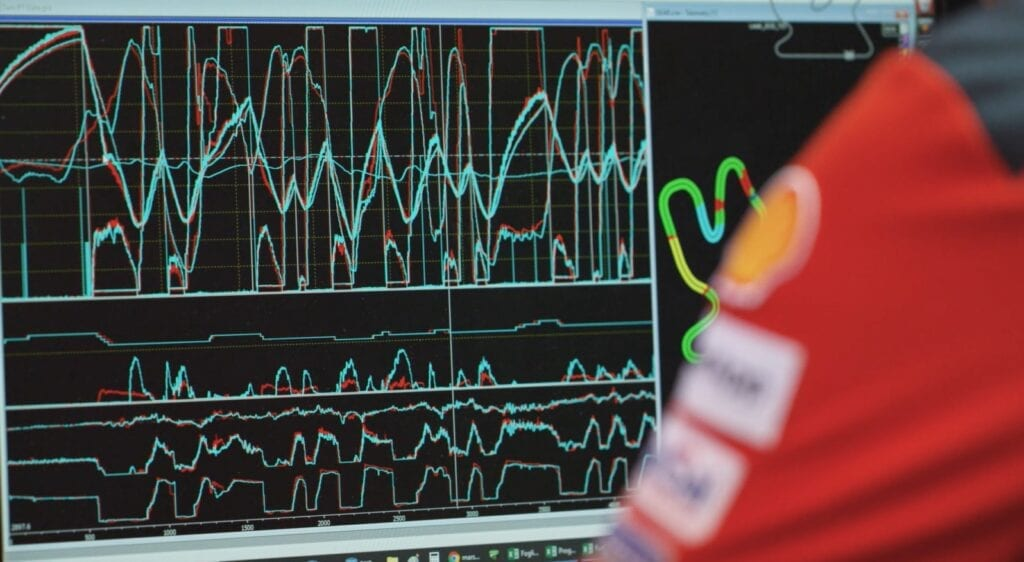 Ducati team member reviewing a data readout on a screen