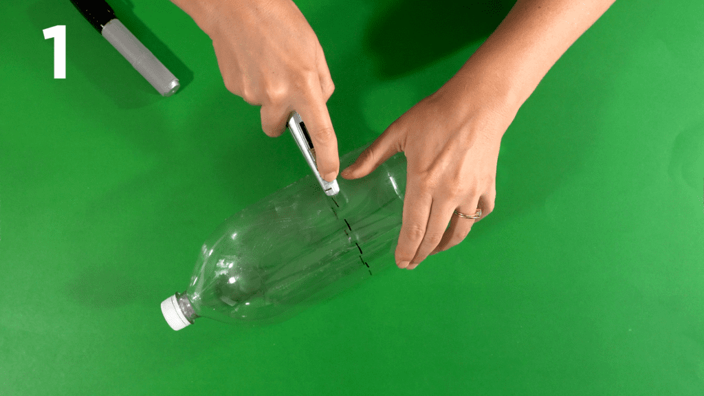 Mark your soda bottle with a marker and cut with utility knife.