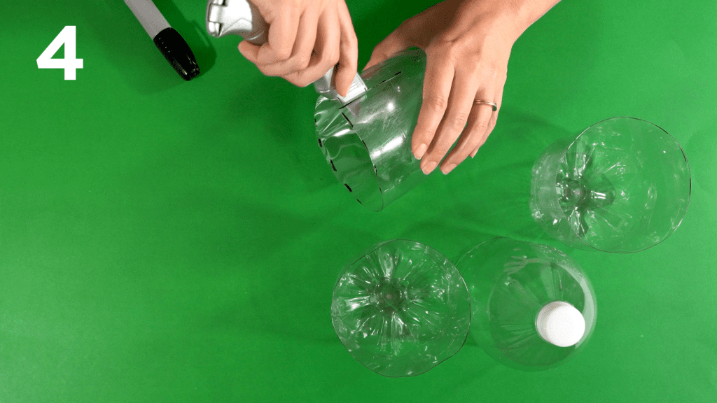 Mark and make an additional cut up the side of the second soda bottle.