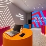 Spazio Lenovo: concept store interior with brightly colored furniture and demo devices