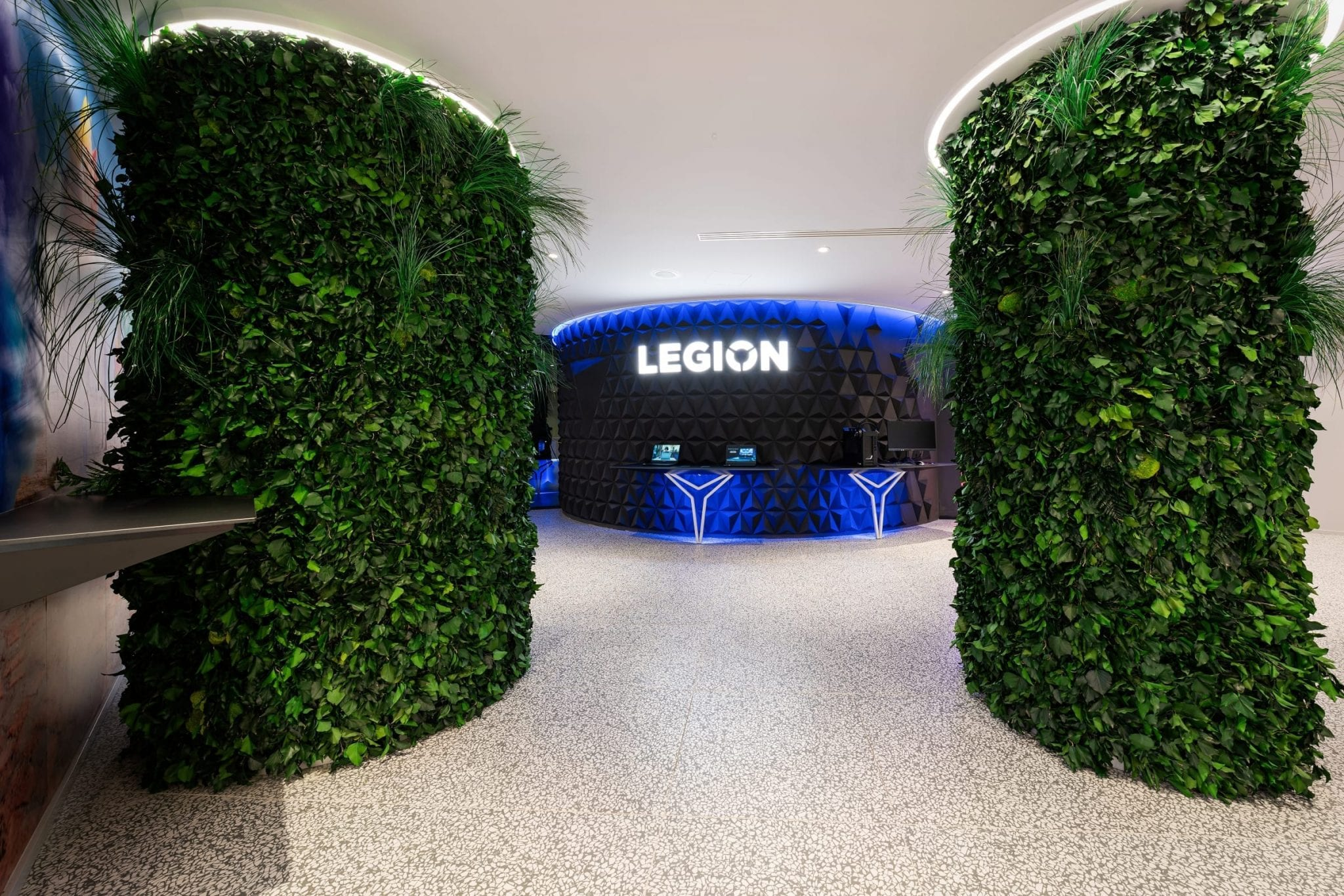Spazio Lenovo concept store interior with vertical plant displays and Lenovo Legion devices