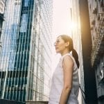 Lenovo brand image - woman standing alone surrounded by city skyscrapers