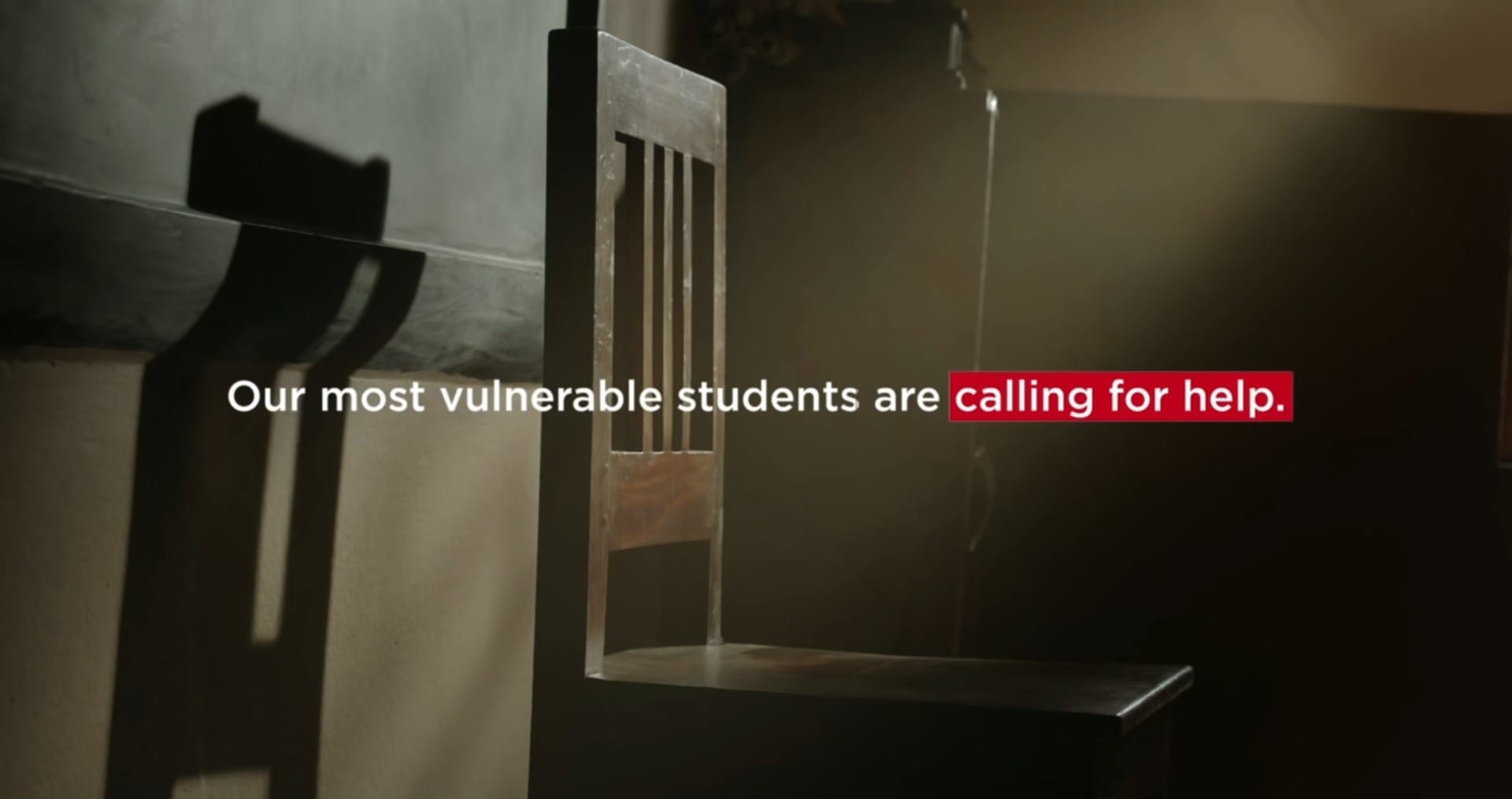 Text in image over empty chair: our most vulnerable students are calling for help