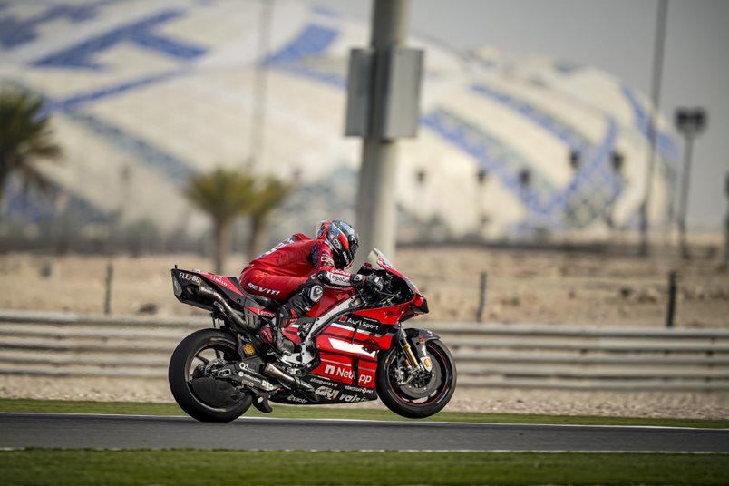 Ducati motorbike racing along a track