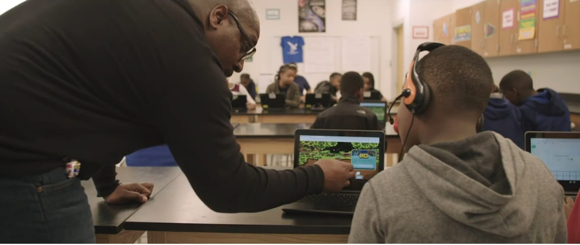 Teacher working with students in Baltimore using Lenovo devices to learn.