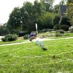 STEM at Home bottle rocket blasting off in a grassy yard