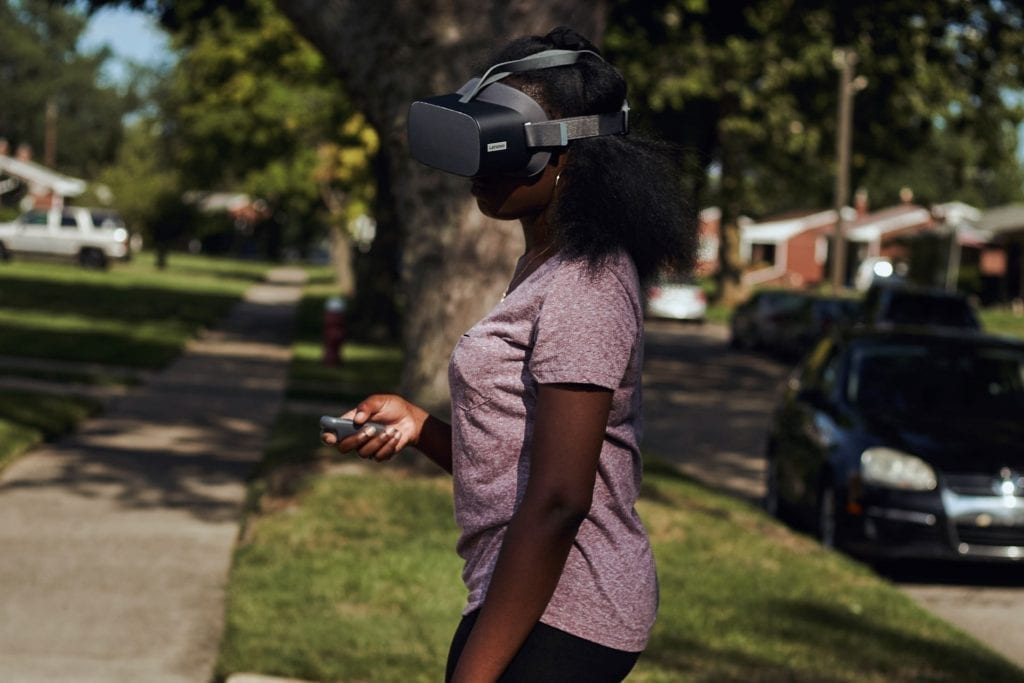 New Realities - USA - Kemi Dauda using a Lenovo VR headset outside