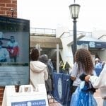 Attendees at the Oct. 10 UNC football game pass one of the Health Greeter Kiosks, which confirms two people are correctly wearing masks.