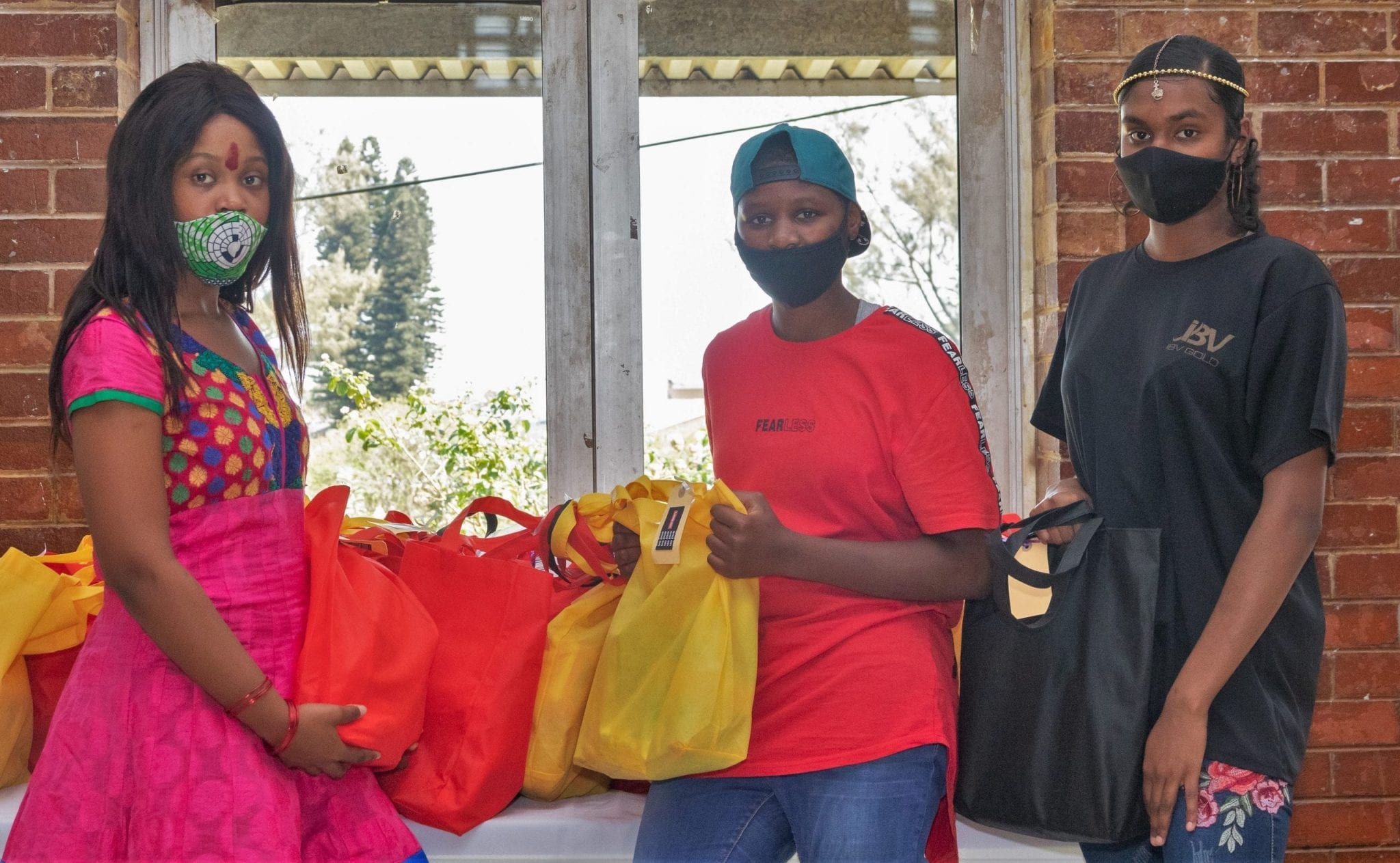 Residents of the St Monica's Child and Youth Care Centre in South Africa collecting the donated bags of sanitary products.