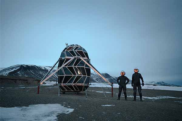 Sebastian and Karl outside the module in Greenland at the beginning of the expedition. Heavily compressed image shared via satellite phone with mission control. Courtesy SAGA Space Architects.