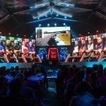 MotoGP eSport participants at a gaming event.