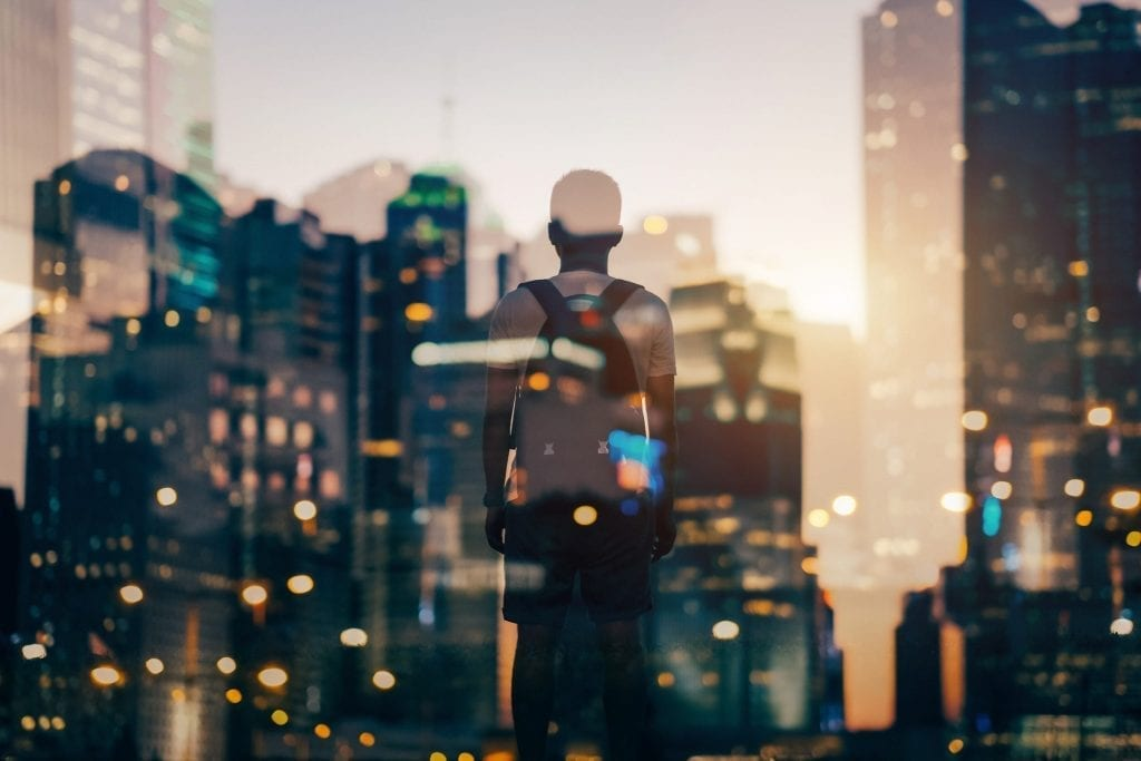 Lenovo brand image of student with backpack and a cityscape overlay