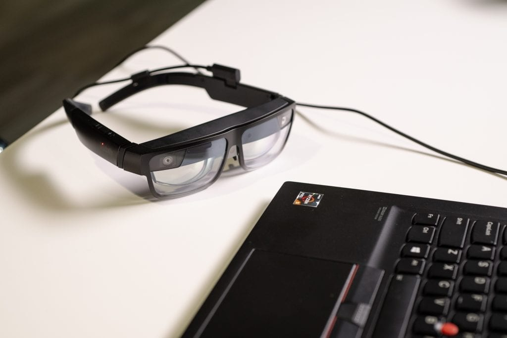 ThinkReality A3 Smart Glasses sitting beside a Lenovo ThinkPad