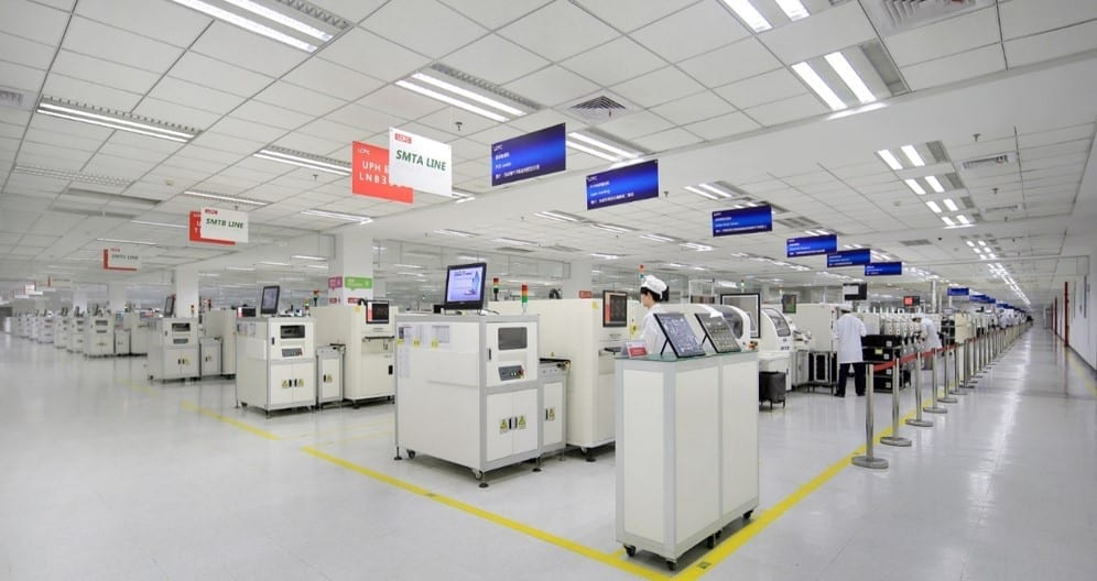 Lenovo's LCFC PC production facility, wide view of different stations in a bright, white warehouse