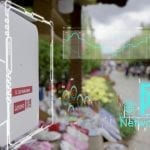 5G service box in Lijiang with technology graphics overlay showing different data