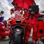 Ducati motorbike with a pit crew working and diagnosing with a Lenovo laptop plugged into the bike