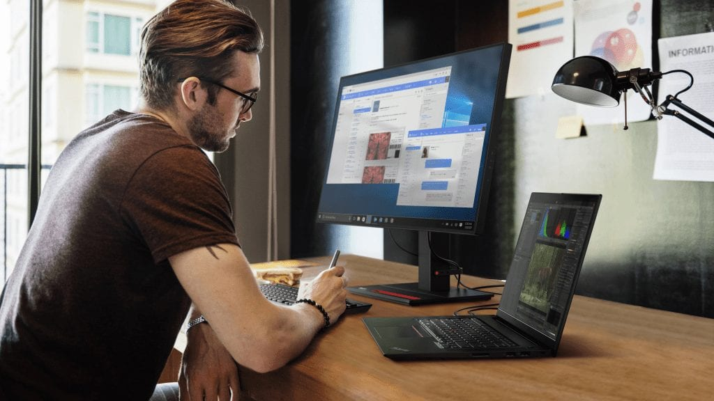 Person sitting at desk with ThinkPad X1 Extreme Gen 4 hooked up to an external monitor