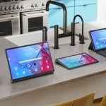New Lenovo tablets and smart devices lined up on a kitchen counter