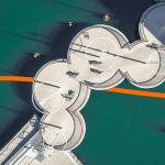 Lenovo Beyond Boundaries image - orange ribbon moving through an overhead shot of round bike paths
